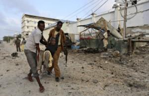 Residents evacuate an injured boy after Islamist group al Shabaab attacked Maka Al-Mukarama hotel in Mogadishu