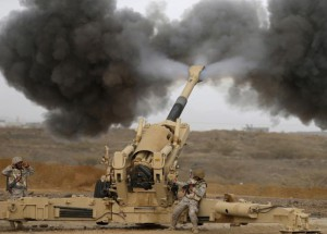 A Saudi artillery unit fires shells towards Houthi positions from the Saudi border with Yemen