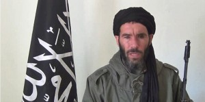 "An undated grab from a video obtained by ANI Mauritanian news agency reportedly shows former Al-Qaeda in the Islamic Maghreb (AQIM) emir Mokhtar Belmokhtar speaking at an undisclosed location. Islamists held 41 foreigners hostage, including seven Americans, after an attack on a gas field in eastern Algeria on January 16. The Algerian military launched on January 17, 2013 an air and ground assault on a desert gas complex where Islamists were holding hostages, one of the kidnappers told the ANI news agency. FP PHOTO / HO / ANI ==RESTRICTED TO EDITORIAL USE - MANDATORY CREDIT ""AFP PHOTO / HO / ANI"" - NO MARKETING NO ADVERTISING CAMPAIGNS - DISTRIBUTED AS A SERVICE TO CLIENTS =="