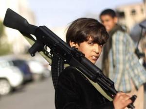 29-yemeni-boy-gun-ap