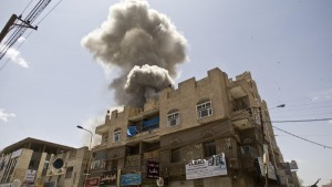 FILE - In this Sunday, May 10, 2015 file photo, smoke rises from a house of former Yemeni president Ali Abdullah Saleh after a Saudi-led airstrike in Sanaa, Yemen. (AP Photo/Hani Mohammed, File)