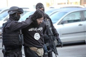 In this photo provided by State Investigation and Protection Agency of Bosnia and Herzegovina show  members of the police force escorting Bosnian man Kenan Krso,  for questioning in Sarajevo, on Wednesday, April 15, 2015. Bosnian authorities say they arrested a terrorism suspect who visited Syria and keeps in touch with Bosnians who fight for the Islamic State group there which is against the law in Bosnia.  According to Wednesday's statement from the prosecution office, Kenan Krso, 39, is also suspected of causing incidents and disturbing the public in Sarajevo.  Media said Krso ran around Sarajevo in T-shirts with symbols of the Islamic State and he disturbed prayers in a mosque and insulted the imam. Police found an unregistered weapon in his house.  (STATE INVESTIGATION AND PROTECTION AGENCY OF BiH via AP)