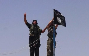 "An image made available by the jihadist Twitter account Al-Baraka news on June 11, 2014 allegedly shows militants of the jihadist group Islamic State of Iraq and the Levant (ISIL) hanging the Islamic Jihad flag on a pole at the top of an ancient military fort after they cut a road through the Syrian-Iraqi border between the Iraqi Nineveh province and the Syrian town of Al-Hasakah. AFP PHOTO / HO / ALBARAKA NEWS === RESTRICTED TO EDITORIAL USE - MANDATORY CREDIT ""AFP PHOTO / HO / ALBARAKA NEWS"" - NO MARKETING NO ADVERTISING CAMPAIGNS - DISTRIBUTED AS A SERVICE TO CLIENTS FROM ALTERNATIVE SOURCES, AFP IS NOT RESPONSIBLE FOR ANY DIGITAL ALTERATIONS TO THE PICTURE'S EDITORIAL CONTENT, DATE AND LOCATION WHICH CANNOT BE INDEPENDENTLY VERIFIED ==="