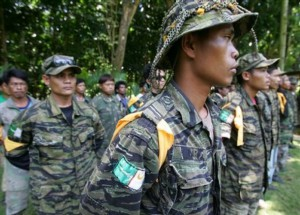 Some of the 31 members of the rebel group Moro Islamic Liberation Front stand in formation as they are presented to the media Thursday, Aug. 21, 2008 in a military camp in Iligan City in southern Philippines. The group allegedly belonging to Commander Bravo who rampaged in two towns last Monday, surrendered after refusing orders to kill civilians. The government demanded the surrender of two Muslim guerilla commanders blamed for attacks that killed dozens of people. (AP Photo/Pat Roque)