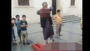 isis-behead-libyan-soldier.si