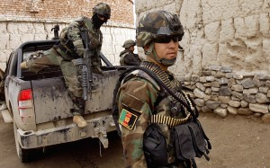 Afghan National Army Commandos interact with the local population during a mission to hand out humanitarian aid in Salerno Afghanistan. The Commandos are an elite fighting force, hand picked from the best of the Afghan National Army (Released) Ê