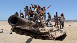 Anti-Houthi fighters of the Southern Popular Resistance stand on a tank in Yemen's southern port city of Aden May 10, 2015. REUTERS/Stringer      TPX IMAGES OF THE DAY