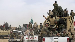 Shi'ite paramilitaries riding military vehicles travel from Lake Tharthar toward Ramadi to fight against Islamic state militants, west of Samarra, Iraq May 27, 2015. A campaign led by Shi'ite paramilitaries to drive Islamic State militants from Iraq's Sunni heartland was rebranded on Wednesday after criticism that the name chosen for the push was overtly sectarian. REUTERS/Stringer