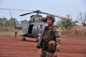 A French soldier stands guard in front of a helicopter transporting French army general Francesco Soriano (unseen), the commander of the French-led 'Operation Sangaris' in Central Africa, during a visit in the town of Yaloke, north of Bangui, on February 2, 2014. Around 200 rebel fighters in the Central African Republic who surrendered to African Union troops who retook the key town of Sibut at the weekend fled overnight, a military source said on February 2.  AFP PHOTO/ ISSOUF SANOGO        (Photo credit should read ISSOUF SANOGO/AFP/Getty Images)