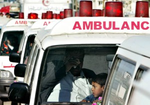 A Palestinian cries as the body of a relative of his is brought among the 15 Palestinian militants bodies in ambulances in the Gaza Strip, February 14, 2005.Thousands of Palestinians, some wearing mock suicide-bomber belts, lined Gaza roads on Monday to welcome home the remains of 15 gunmen handed over by Israel in a gesture to help President Mahmoud Abbas shore up a ceasefire. REUTERS/Ahmed Jadallah  AJ/ABP - RTRNBGE