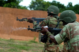 BEMBEREKE, Benin (June 16, 2009) - Beninese soldiers fire on the move as part of a joint U.S.-Benin live fire exercise in preparation for SHARED ACCORD 2009's final field training event. SHARED ACCORD is a scheduled, combined U.S.-Benin exercise designed to improve interoperability and mutual understanding of each nation's military tactics, techniques and procedures. Humanitarian and civil affairs events run concurrent with the military training. The exercise is scheduled to conclude June 25. (Official Marine Corps photo by Lance Cpl. Jad Sleiman)