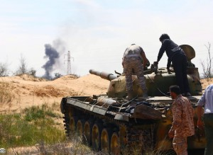 A file photo of a Libyan militia in command of a tank, clashing with rivals near Bir al-Ghanam, 90 km north of Tripoli, Libya, 19 March 2015. At least 106 people were killed in three days of fighting between Islamic State loyalists and local tribesmen in Libya's city of Sirte. EPA/STR