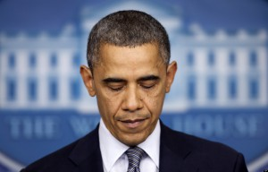 President Barack Obama pauses as he talks about the Connecticut elementary school shooting, Friday, Dec. 14, 2012, in the White House briefing room in Washington. (AP Photo/Carolyn Kaster)