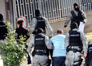 Macedonian special police forces escort a man, suspected to be linked in the killings of five people at the Smiljkovci lake in April, to the examining judge offices in Skopje on May 2, 2012. Macedonian police announced yesterday that they arrested 20 radical Muslims, suspected to be members of a terrorist group which has been linked to the murder of five Macedonians in early April. On April 12 five men, one 45 years old and the others aged between 18 and 22, were found dead from gunshot wounds at a popular fishing pond near Skopje. AFP PHOTO/ROBERT ATANASOVSKI