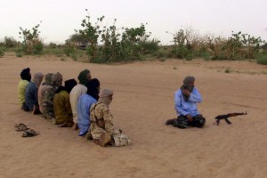 The leader of the Coordination of Azawad Movements (CMA), Mohamed Ag Najim (R), leads his men in prayer outside Anefis, Mali, August 26, 2015.   REUTERS/Souleymane Ag Anara