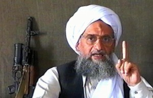 """-, -:  (FILES) -- A TV grab from the Qatar-based Al-Jazeera news channel dated 17 June 2005 shows Al-Qaeda number two Ayman al-Zawahiri delivering a speech at an undisclosed location with a machine gun next to him. Al-Zawahiri, in a video posted on the Internet 29 September 2006, called US President George W Bush a liar who had """"failed in his war against Al-Qaeda"""", Al-Jazeera television reported. The previous day, Islamist websites on the Internet had said there would be a new video message posted by Zawahiri entitled """" Bush, the pope, Darfur and the Crusades.""""  AFP PHOTO/AL-JAZEERA  -- QATAR OUT & INTERNET OUT --  (Photo credit should read -/AFP/Getty Images)"""