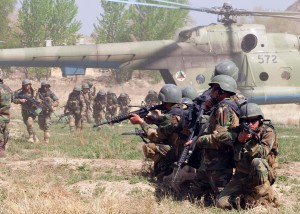 Afghan Commandos from the Sixth Commando Kandak practices infiltration techniques using the Afghan National Army Air Corps Mi-17 helicopter on April 1 at Camp Morehead in the outer regions of Kabul. The training was in preparation for future air assault missions needed in order to disrupt insurgent activity and bring stability to the population and the region.