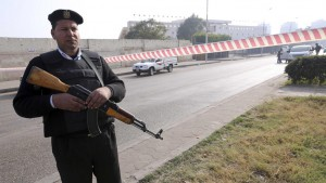 A member of the Egyptian security services guards the site of a bomb blast near the Alf Maskan district of Cairo, January 25, 2015. The bomb wounded two Egyptian policemen in Cairo and security forces quickly dispersed small protests on Sunday, the anniversary of a popular uprising that toppled autocrat Hosni Mubarak in 2011, officials said.The blast targeted policemen stationed outside a sports club in Cairo's Heliopolis area, security sources said. REUTERS/Mohamed Abd El Ghany (EGYPT - Tags: POLITICS CIVIL UNREST)