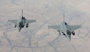 "A handout picture taken by EMA and released on September 15, 2014 by ECPAD shows two Rafale fighter jets flying on a reconnaissance mission over Iraq after taking off from the Al-Dhafra base in the United Arab Emirates. The world's top diplomats pledged on September 15 to support Iraq in its fight against Islamic State militants by ""any means necessary"", including ""appropriate military assistance"", as leaders stressed the urgency of the crisis. Representatives from around 30 countries and international organisations, including the United States, Russia and China, gathered in Paris as the savage beheading over the weekend of a third Western hostage raised the stakes in the battle against the marauding jihadists.   AFP PHOTO / ECPAD / EMA /ARMEE DE L'AIR = RESTRICTED TO EDITORIAL USE - MANDATORY CREDIT ""AFP PHOTO / ECPAD / EMA /ARMEE DE L'AIR"" - NO MARKETING NO ADVERTISING CAMPAIGNS - DISTRIBUTED AS A SERVICE TO CLIENTS - TO BE USED WITHIN 30 DAYS FROM 09/15/2014 ="