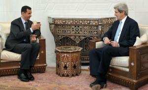 Syria's President Bashar al-Assad (L) meets Senator John Kerry, chairman of the U.S. Senate Foreign Relations Committee, in Damascus February 21, 2009.  REUTERS/Sana (SYRIA) - RTXBW2Q