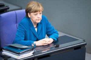 German Chancellor Angela Merkel attends a debate on the refugee disaster in the Mediterranean sea in the Bundestag, the German lower house of parliament, in Berlin on April 22, 2015. 800 migrants feared to have died when a boat packed with migrants capsized near Libya. European governments were under mounting pressure to act decisively on the Mediterranean migrant crisis as harrowing details emerged of the fate of those who died in the worst tragedy to date. AFP PHOTO / DPA / MAURIZIO GAMBARINI   +++ GERMANY OUT +++