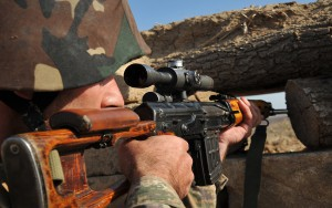Caption:An Armenian soldier of the self-proclaimed republic of Nagorno-Karabagh aims his sniper rifle at the frontline on the border with Azerbaijan, on October 25, 2012. Armenia-backed separatists seized Karabakh from Azerbaijan in a war in the 1990s that left some 30,000 dead, and no final peace deal has been signed since the1994 ceasefire. AFP PHOTO / KAREN MINASYAN (Photo credit should read KAREN MINASYAN/AFP/Getty Images)