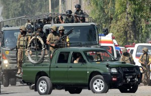 Pakistani soldiers arrive to take position outside a Pakistan Air Force base after an attack by militants in Peshawar on September 18, 2015. Militants attacked a Pakistani air force base near the northwestern city of Peshawar, the military said, adding that at least six attackers had been killed and 10 soldiers injured. AFP PHOTO / A MAJEED