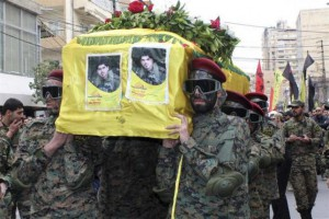 Lebanon's Hezbollah members carry the coffin of their comrade Ahmad Ali Deeb, who was killed in the recent battles in Yabroud, Syria, during his funeral in Tyre city, southern Lebanon, March 16, 2014. REUTERS/Haidar Hawila
