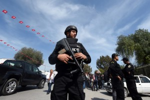 """Tunisian security forces stand guard near the National Bardo Museum in Tunis on March 19, 2015, in the aftermath of an attack on foreign tourists. Tunisia's president promised to wage a """"merciless war against terrorism"""" after gunmen killed at least 17 foreign tourists and two Tunisians in a daylight attack in the birthplace of the Arab Spring. AFP PHOTO / FETHI BELAID"""