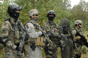Special Operations Forces operators representing Croatia (first and third from left), the U.S. (second from left) and Poland (first and second from right), wear a variety of gear on Sept. 20 at Drawksow Pomorskie, Poland during a press conference as part of the official start of the Jackal Stone 10 exercise. Jackal Stone 10, hosted by Poland and Lithuania this year, is an annual international special operations forces (SOF) exercise held in Europe. Its objective is to enhance capabilities and interoperability amongst the participating special operations forces and as well as build mutual respect while sharing doctrinal concepts. The exercise, which is coordinated with U.S. Special Operations Command Europe, includes countries from Poland, Lithuania, Latvia, Croatia, Romania, and Ukraine participating in the exercise. (U.S. Army photo by Master Sgt. Donald Sparks)