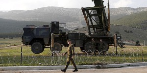 Soldiers of the German armed forces Bundeswehr stand next to the Patriot system before the arrival of Germany's Chancellor Angela Merkel at a Turkish military base in Kahramanmaras in this February 24, 2013 file photo. The United States and Germany said they will pull Patriot missile batteries from southern Turkey after a reassessment of the threats stemming from the conflict in neighbouring Syria. The U.S. Patriots, in Turkey as part of a broader NATO mission since 2013, will be redeployed to the United States for upgrades, according to a joint Turkish-U.S. statement on Sunday. German Defence Minister Ursula von der Leyen announced at the weekend that Berlin would let its three-year Patriot mission lapse in January instead of seeking parliamentary approval to extend it. REUTERS/Murad Sezer/Files