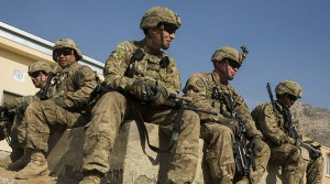 U.S. soldiers from the 3rd Cavalry Regiment gather inside an Afghan police station constructed by ISAF near Jalalabad in the Nangarhar province of Afghanistan December 20, 2014. REUTERS/Lucas Jackson (AFGHANISTAN - Tags: CIVIL UNREST POLITICS MILITARY) - RTR4IRWH
