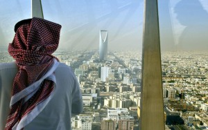 A+man+looks+at+central+Riyadh+from+the+Faisaliah+Tower,+Saudi+Arabia.