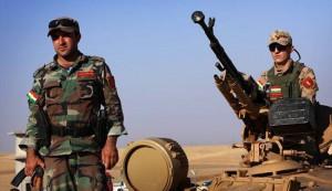 Iraqi Kurdish Peshmerga fighters take position on the front line in Khazer, near the Kurdish checkpoint of Aski kalak, 40 km West of Arbil, the capital of the autonomous Kurdish region of northern Iraq, on August 8, 2014.