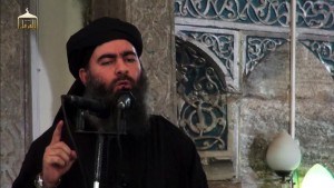 """An image grab taken from a propaganda video released on July 5, 2014 by al-Furqan Media allegedly shows the leader of the Islamic State (IS) jihadist group, Abu Bakr al-Baghdadi, aka Caliph Ibrahim, adressing Muslim worshippers at a mosque in the militant-held northern Iraqi city of Mosul. Baghdadi, who on June 29 proclaimed a """"caliphate"""" straddling Syria and Iraq, purportedly ordered all Muslims to obey him in the video released on social media.    AFP PHOTO / HO / AL-FURQAN MEDIA  == RESTRICTED TO EDITORIAL USE - MANDATORY CREDIT """"AFP PHOTO / HO / AL-FURQAN MEDIA """" - NO MARKETING NO ADVERTISING CAMPAIGNS - DISTRIBUTED AS A SERVICE TO CLIENTS FROM ALTERNATIVE SOURCES, AFP IS NOT RESPONSIBLE FOR ANY DIGITAL ALTERATIONS TO THE PICTURE'S EDITORIAL CONTENT, DATE AND LOCATION WHICH CANNOT BE INDEPENDENTLY VERIFIED =="""
