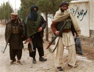 Taliban militants hand over their weapons after joining the Afghan government's reconciliation and reintegration program, in Herat, January 30, 2012. REUTERS/Mohammad Shoiab