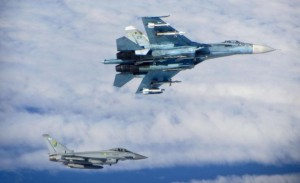 A Russian Sukhoi Su-27 fighter (top) is seen with a British Royal Air Force (RAF) Typhoon fighter as they fly in international airspace near the Baltic States in this photograph taken on June 17, 2014 and received via Britain's Ministry of Defence (MoD) in London on June 18, 2014. Britain said on Wednesday it had scrambled Typhoon fighter jets to intercept seven Russian military aircraft flying near the Baltic states as tensions between the West and Russia over the Ukraine crisis remained high. Picture taken June 17, 2014.   REUTERS/RAF/MoD/Crown Copyright/Handout via Reuters ( Tags: MILITARY TRANSPORT) ATTENTION EDITORS - THIS PICTURE WAS PROVIDED BY A THIRD PARTY. REUTERS IS UNABLE TO INDEPENDENTLY VERIFY THE AUTHENTICITY, CONTENT, LOCATION OR DATE OF THIS IMAGE  THIS PICTURE IS DISTRIBUTED EXACTLY AS RECEIVED BY REUTERS, AS A SERVICE TO CLIENTS THIS IMAGE HAS BEEN SUPPLIED BY A THIRD PARTY. IT IS DISTRIBUTED, EXACTLY AS RECEIVED BY REUTERS, AS A SERVICE TO CLIENTS. FOR EDITORIAL USE ONLY. NOT FOR SALE FOR MARKETING OR ADVERTISING CAMPAIGNS. NO SALES. NO ARCHIVES