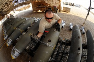 Master Sgt. Adam, NCO-in-charge of conventional maintenance, lines up bomb lugs on MK-82 munitions Dec. 21, 2014, in Southwest Asia, to ensure they are prepared to sync up with aircraft racks during installation.  Adam, deployed from Seymour Johnson Air Force Base, N.C., has been an Ammo troop for 14 years.  (U.S. Air Force photo/Senior Master Sgt. Carrie Hinson)