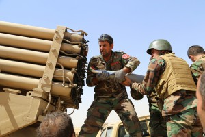 MOSUL, IRAQ - AUGUST 8:  Kurdish peshmerga fighters load missile launcher during the clashes with the army groups led by Islamic State of Iraq and the Levant (ISIL) in Mosul, Iraq on 8 August, 2014. (Photo by Feriq Ferec/Anadolu Agency/Getty Images)