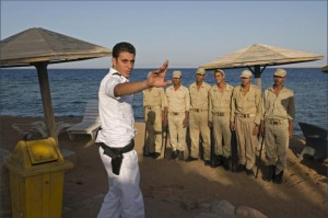 DAHAB, EGYPT: A Mubarak era police officer stops the photographer from taking a pictures in Dahab, Egypt.