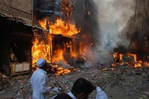 Flame-breaks-out-after-an-explosion-in-Peshawar-Pakistan-on-Wednesday-Oct.-28-2009.-A-car-bomb-has-torn-through-a-market-place-in-northwestern-Pakistan