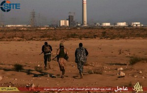 """An image taken from jihadist media outlet Wilayat Trablus and provided courtesy of the US-based monitoring agency SITE Intelligence Group on June 9, 2015 allegedly shows Islamic State (IS) group fighters running towards what they say is a power plant in the southern Libyan city of Sirte after IS claimed to have seized full control of the city from Fajr Libya militia. AFP PHOTO / HO / SITE INTELLIGENCE GROUP == RESTRICTED TO EDITORIAL USE - MANDATORY CREDIT """"AFP PHOTO / HO / SITE INTELLIGENCE GROUP - NO MARKETING NO ADVERTISING CAMPAIGNS - DISTRIBUTED AS A SERVICE TO CLIENTS FROM ALTERNATIVE SOURCES, AFP IS NOT RESPONSIBLE FOR ANY DIGITAL ALTERATIONS TO THE IMAGE / AFP / SITE Intelligence Group / HO"""