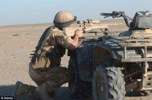 An SAS sniper takes up a position whilst on duty in Helmand province, Afghanistan. SAS members would be armed to take out high-value Isis targets in Libya