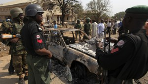 Security forces view the scene of a bomb explosion at St. Theresa Catholic Church at Madalla, Suleja, just outside Nigeria's capital Abuja, December 25, 2011. Five bombs exploded on Christmas Day at churches in Nigeria, one killing at least 27 people, raising fears that Islamist militant group Boko Haram - which claimed responsibility - is trying to ignite sectarian civil war. REUTERS/Afolabi Sotunde (NIGERIA - Tags: CRIME LAW RELIGION)