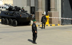 """A picture taken on December 10, 2015 shows Saudi security members stand guard at the gate of Diriyah Palace where the 136th Gulf Cooperation Council (GCC) summit is being held in Riyadh. Kings and emirs from six Gulf states began two days of talks, at the same time as unprecedented discussions by the Syrian opposition at a luxury hotel in another part of the city. Saudi King Salman bin Abdulaziz called for political solutions to the wars in Syria and Yemen, while condemning """"terrorism,"""" at the opening of the annual Gulf summit. AFP PHOTO / FAYEZ NURELDINE / AFP / FAYEZ NURELDINE"""