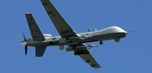 """CREECH AIR FORCE BASE, NV - AUGUST 08:  An MQ-9 Reaper flies by August 8, 2007 at Creech Air Force Base in Indian Springs, Nevada. The Reaper is the Air Force's first """"hunter-killer"""" unmanned aerial vehicle (UAV), designed to engage time-sensitive targets on the battlefield as well as provide intelligence and surveillance. The jet-fighter sized Reapers are 36 feet long with 66-foot wingspans and can fly for up to 14 hours fully loaded with laser-guided bombs and air-to-ground missiles. They can fly twice as fast and high as the smaller MQ-1 Predators, reaching speeds of 300 mph at an altitude of up to 50,000 feet. The aircraft are flown by a pilot and a sensor operator from ground control stations. The Reapers are expected to be used in combat operations by the U.S. military in Afghanistan and Iraq within the next year.  (Photo by Ethan Miller/Getty Images)"""