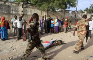 somali-police-walk-past-body-suspected-al-shabaab-militant-who-was-killed-explosion-while