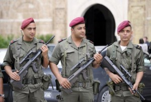 Tunisian soldiers stand guard in front of the Prime Minister's offices in Tunis, on June 14, 2012. Tunisian police arrested 90 people on June 12 including Islamist hardliners over a series of attacks on government offices and clashes with security forces overnight, the interior ministry said on June 12. Police fired tear gas to repel the violent rampage by a mixed group of ultra-conservative Salafists and other attackers, who torched and pillaged a local court in west Tunis and attacked several police stations in the north of the capital, ministry spokesman Khaled Tarrouche said. AFP PHOTO /FETHI BELAID