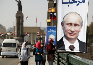Girls walk past a banner with a picture of Russian President Vladimir Putin along a bridge, in central Cairo February 9, 2015. Putin is due to arrive on Monday on his first visit to Egypt in ten years. REUTERS/Asmaa Waguih(EGYPT - Tags: POLITICS)