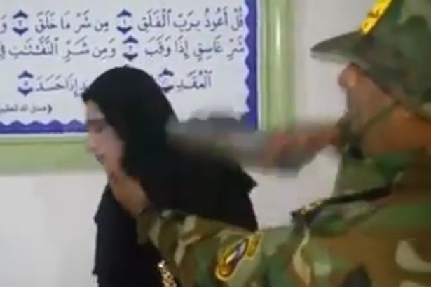 ISIS fighter dresses up as a woman in attempt to escape